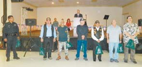VETERANS FROM THE NORTH CHANNEL COMMUNITY are pictured at the Salute, receiving recognition and a back-pack of gifts as part of the North Channel Chamber event put on with the help of the North Shore and Galena Park Rotary Clubs, and major sponsors. Behind the veterans are the speakers for the day.