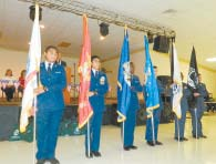 SERVICE FLAGS were presented for each of the Armed Services by members of the Channelview ROTC.
