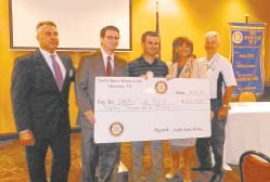 North Shore Rotary Club presents a check to Harris County Pct. 2 Commissioner Jack Morman, second from left, toward the construction of a pedestrian Bridge in North Shore Park on Wallisville Road. The bridge will connect two parts of the park making it much more accessible for families and sports groups. Participating with Morman are Rotarians Mike Williams, president Matt Davis, Alatia Harris, and Derrill Painter.