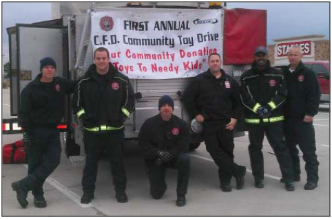 Channelview Fire Department crew collecting toys.