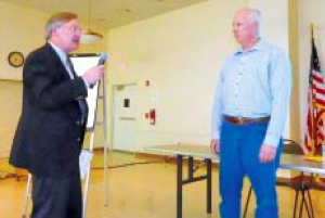 Fred Lewis, president of TexansTogether, confronts EPA Project Man- ager Gary Miller with a series of questions regarding the lack of envi- ronmental health studies by the state and federal agencies, and the standards being used by EPA to make judgments on the Waste Pits.