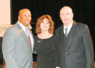 NEW CHAMBER PRESIDENT MARGIE BUENTELLO poses with outgoing board chair Wilfred Broussard, Jr. and new chair Greg Ollis.