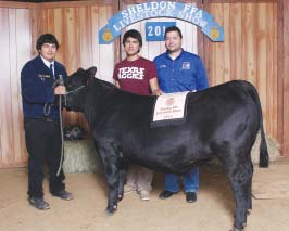 GRAND CHAMPION STEER was exhibited by Ryan Rodriguez, left, and purchased by Fred Rivas.