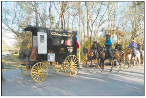 THE WAGON HEARSE of Robert Joe continued in the Trail Ride, after the untimely death of Mr. Joe.