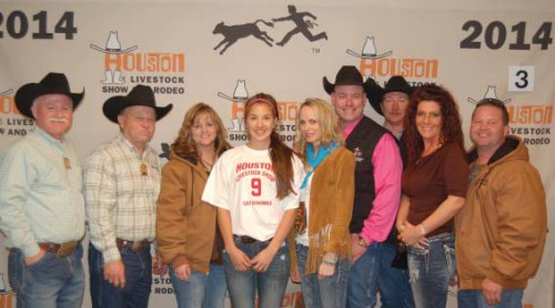 Yvette Leos, center, is all smiles after catching a calf at the 2014 Houston Livestock Show and Rodeo Calf Scramble. Celebrating the achievement are, from left, Channelview High School Agriculture instructors Wesley Hutchins and Dominic Mazoch and representatives from Rockin' D Fencing Co., owned by Adan DeSplinter.