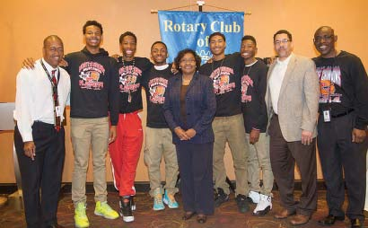 (l/r): David Green - Head Coach, Jarrey Foster, Kerwin Roach, Brandon Etienne, Dr. Angi Williams - Super- intendent of Schools, Brandon Green, Jalin Hart, Kenneth Coleman - Assistant Coach, Dr. Joe Coleman - Principal North Shore Senior High School. (Photo Courtesy Jonathan Frey/GPISD)