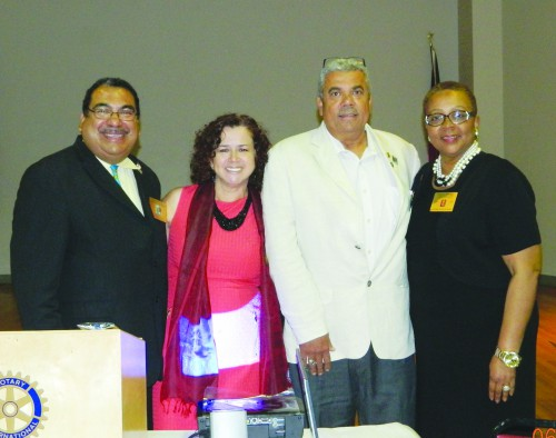 "NEWLY INSTALLED ROTARY PRESIDENT MARIA RODRIGUEZ, SECOND FROM LEFT, WITH OUTGOING PRESIDENT ERNESTO PAREDES, SECRETARY ""ABBY"" ABOUAWDI, AND PRESIDENT ELECT PAUL HENNEY."