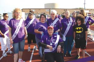 100-year-old Lavoice Smallwood, center, along with her family prepares to lead cancer survivors in the Survivor's Lap. Smallwood was the honored guest at North Channel Area's Relay for Life May 2.
