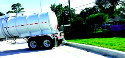 An 18-wheeler truck with hazardous cargo parks within 30 feet of children's swimming pool. The pool can be observed at the back right side. (Submitted Photo)