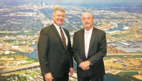 Port of Houston CEO Roger Guenther, left, updated the Chamber on recent activities and future goals of the Port. He was introduced by Chamber Chair Greg Ollis, right.