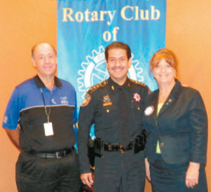 HARRIS COUNTY SHERIFF ADRIAN GARCIA, center, spoke to the North Shore Rotary Club last Thursday at their regular luncheon. With the Sheriff are pictured club Program Chair Wayne Oquin, and Club President Allatia Harris.