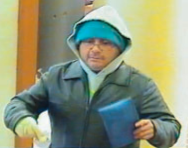 Suspect wanted for bomb threatened in Bank of America robbery.