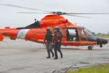 Rep. Babin receives U.S. Coast Guard helicopter tour while surveying the damage and working on response efforts.
