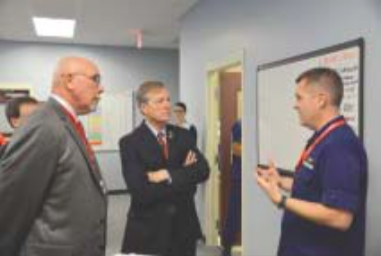 Rep. Babin talking with U.S. Coast Guard Cap. Brian Penoyer.