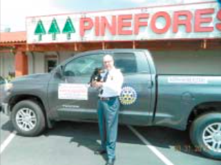 "NORTH SHORE ROTARIAN JIM MILLS, owner of Pineforest Jewelry on Uvalde, displays the Toyota pick-up truck, which is one of the two vehicles that the winner of the Raffle can choose on May 16th. Tickets are available from any Rotarian, or at the Pineforest Jewelry store. Mills dog friend ""Dutch"" might be able to give you a tip on which ticket will be the lucky one."