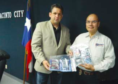 "CONSTABLE CHRIS DIAZ AND JACINTO CITY POLICE CHIEF JOE AYALA display some of the illicit drugs such as ""Kush"" that were confiscated in the area. New ordinances in Jacinto City and Galena Park will give officers more authority to remove these drugs from their communities."