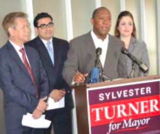 Sylvester Turner, third from left, is endorsed for Houston Mayor by three of his Texas House colleagues at a news conference. With Turner are, left to right, Tim Dinh representing Rep. Hubert Vo, Rep. Armando Walle and Rep. Ana Hernandez.