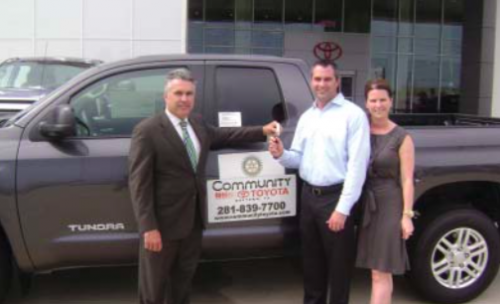 Mike Williams, incoming President of the North Shore Rotary Club, presents the keys to a 2015 Toyota Tundra to raffle winners Mr. and Mrs. Matt Clendenan of Deer Park.