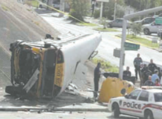 The Houston ISD school bus was eastbound on the South Loop, when a car beside it pulled quickly into its lane, causing the bus to swerve to the right, hit the guard rail, and plummet to the frontage road below.