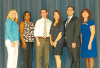 COMMISSIONER MORMAN poses after his talk, with Chamber board members and staff. L to R, Christie Gates, Shalonda Dawkins, Commissioner Morman, Kim Gonzalez, Adam Lund, and Margie Buentello.