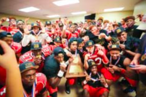 The North Shore Mustangs celebrate their second state championship in the locker room after defeating Austin Westlake 21-14 in overtime. They won also in 2003.