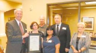 JACINTO CITY issued a Proclamation congratulating Capital Bank on its 50th Anniversary. Pictured at the presentation are bank president Linden Goehring, Mayor Ana Diaz, City Manager Lon Squyres, and other city officials.