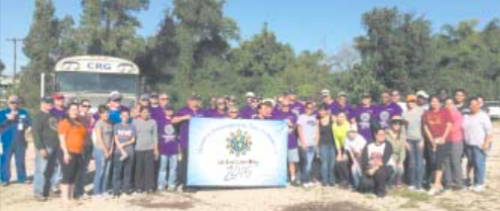 VOLUNTEERS AND LYONDELLBASELL employees gather for a photo after the work session, during Global Care Day at Thomas Bell Foster Park, near I-10 and Normandy Road.