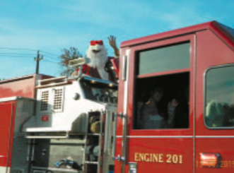 HO! HO! HO! Santa was happy to arrive in Jacinto City in a fire truck, instead of his usual sleight, since there was no snow, just a beautiful sunshiny day.