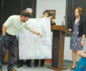 A PROPOSED TRAIL SYSTEM, including walking trails and canoe/kayak trails, is displayed to the Jacinto City Council at a recent meeting, by Charlie Patout of LJA Engineering, at left, and Jill Boullion of Greens Bayou Corridor Coalition, at right.