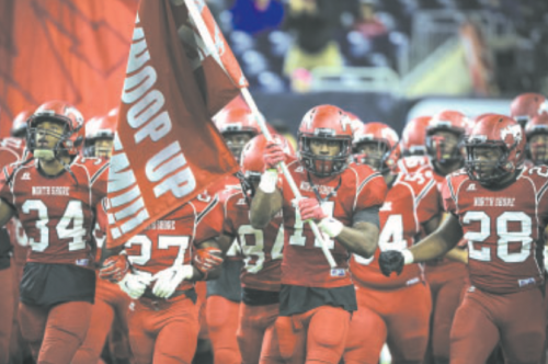 Eric Monroe (#11) leads the charge in the second half, carrying the banner for the Mustangs. Monroe rushed for a 32-yard touchdown and had a key interception. He was also named the Houston Chronicle High School Athlete of the Week for December 15.