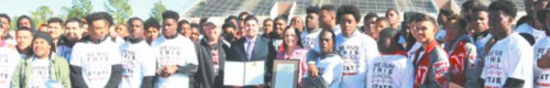 Congressional and State Resolutions noting the successful season are presented to North Shore Head Foorball Coach Jon Kay and the 2015 State Champion North Shore football team by Congressman Gene Green Staff member Jorge Maldonado and State Representative Ana Hernandez last Thursday at the Galena Park Football Stadium. (PHOTO BY ALLAN JAMAIL)