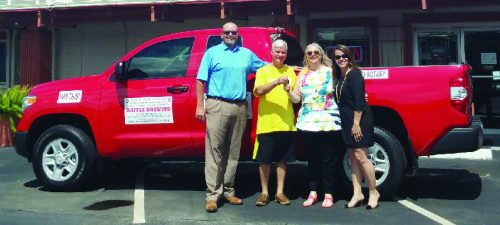 "WINNER OF THE NEW TOYOTA PICK-UP TRUCK at the North Shore Rotary ""Catfish Fry and Crawfish Boil"" was Kimberly Gresham, second from right in this photo. Also congratulating her are Rotarians Shawn Silman, Derrill Painter who sold her the ticket, and Kim Gonzalez, who was chairman of the Fish Fry event this year. (Photo courtesy of Derrill Painter)"