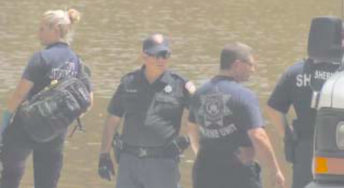 EMERGENCY PERSONNEL from the Sheriff's office, Highlands Fire/EMS, and Houston Marine Unit search the San Jacinto River near Banana Bend for the 50 year old drowning victim last Sunday.