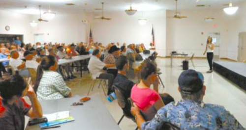 OVER 150 residents who live near the San Jacinto Superfund Waste Pits, packed the Highlands/San Jacinto Community Center last Tuesday night, to hear an update on facts about the Waste Pits, and to get more information on the testing of their well water by the Harris County Polution Control department. Jackie Young, at right, speaks.