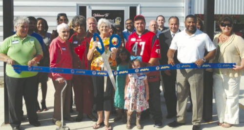 The North Channel Chamber held a ribbon cutting for the new facility, on September 22, Cutting the ribbon is Gayle Redford, with NCAM director Rodney Redford directly behind her.