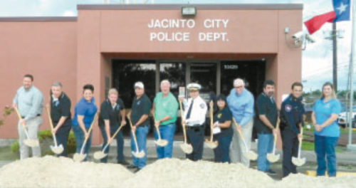 GROUNDBREAKING CEREMONIES FOR THE NEW POLICE STATION took place last Friday morning, in front of the old Police Station. At center, Mayor Ana Diaz and Police Chief Joe Ayala, with City Council persons, City Manager Lon Squyres, Constable Chris Diaz, and Architects Ed and Chris Gant.